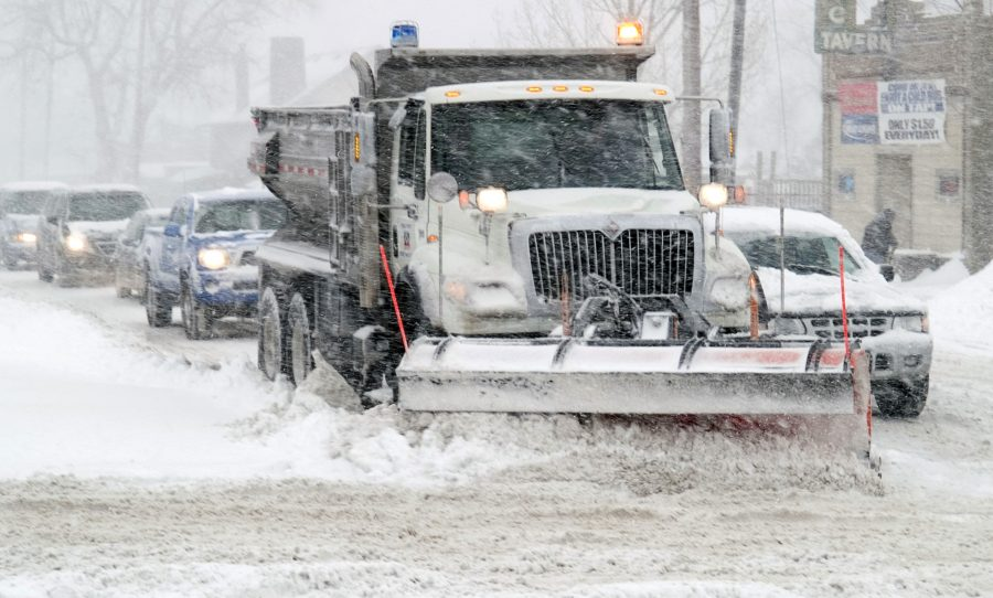 A+snow+plow+clears+off+the+streets+for+drivers+to+continue+on+the+roads+as+snowy+conditions+continue.+