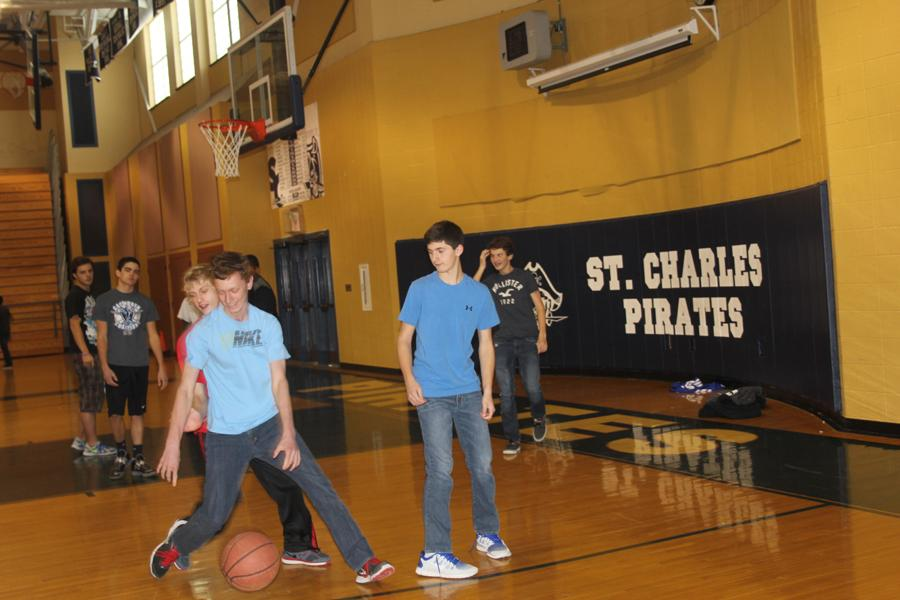 5th hour gym students playing basketball during plus time.