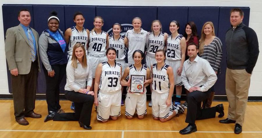 The Lady Pirates basketball team poses with their first place trophy at the Duchesne Holiday Invitational. Sophomore Erica Swinson and juniors Gabby Walker and Whitney Whiteside made the all-tournament team.