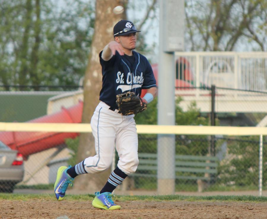Senior Collin Haney fields ground ball and throws to first base for the out against Liberty.