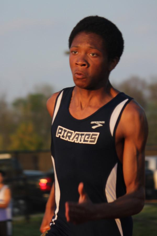 Senior Jason Purley runs a straight away in his 200 meter dash at Fort Zumwalt East.