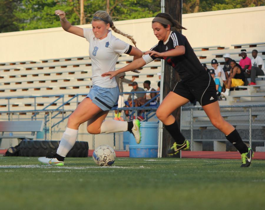 Senior Kendall Keiser fights for the ball against a Winfield defender.