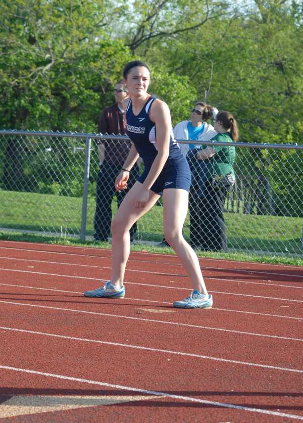 Senior Elissa Rivers awaits the baton in the 100 meter dash at the Culvers Invitational Meet.