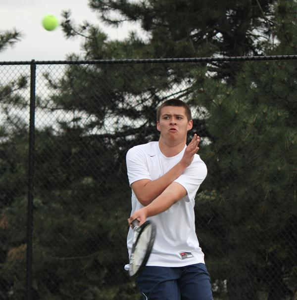 Senior Ben Leimkuehler returns the ball in his singles match versus St. Charles West.