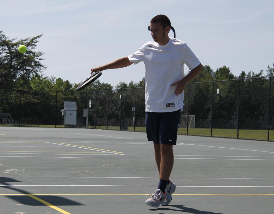 Senior Ben Leimkuehler practices his forehand swing for a tennis match against St. Charles West