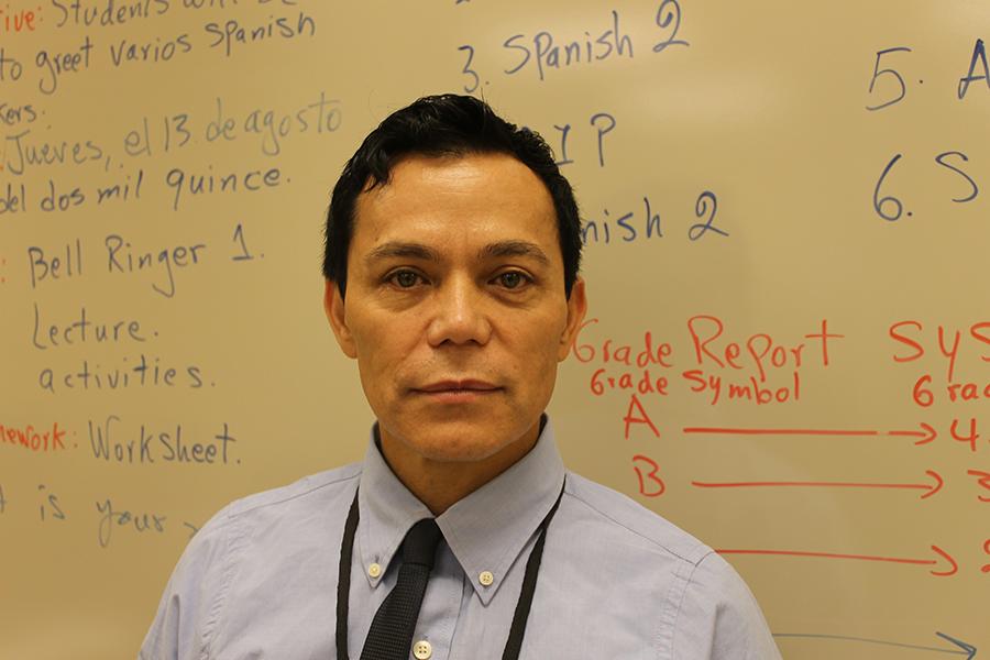 Edgar Montenegro in front of his classroom board.