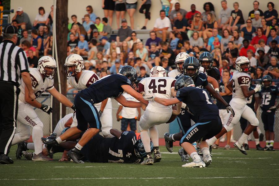 Senior Hunter Bornhop and junior Triston Bayer attempt to tackle a St. Charles West player.