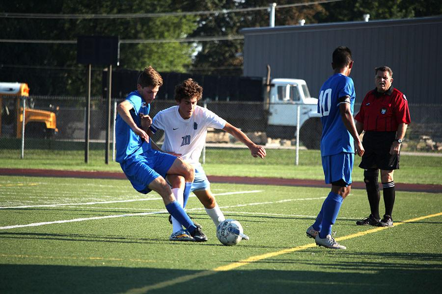 Junior captain Drew Cannon fights for the ball against a Duchesne player.