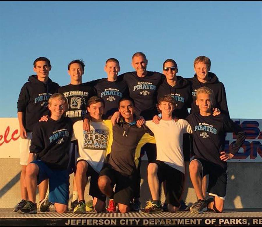 The varsity team poses on the podium on Nov. 7 in Jefferson City at Oak Hills Golf Center
