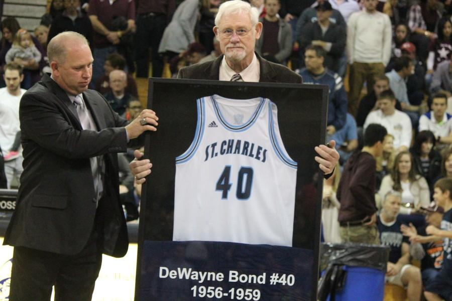Head coach Rick Foster presents former Pirate DeWayne Bond his retired #40 jersey before the varsity boys game on Nov 24 at Turkey Bowl.