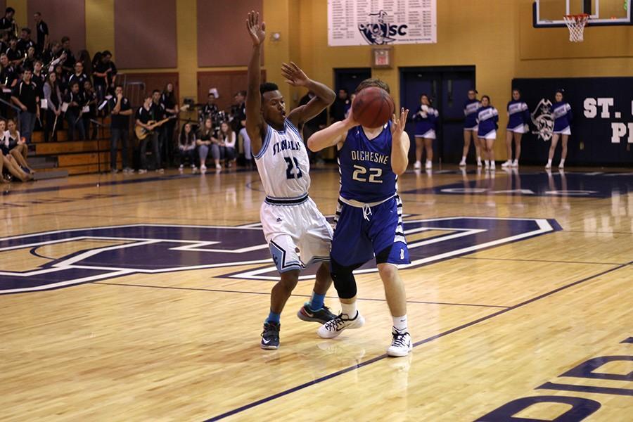 Val Addison plays defense on Duchesne gaurd.
