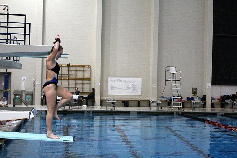 Junior Sarah Bathe prepares to execute her dive.