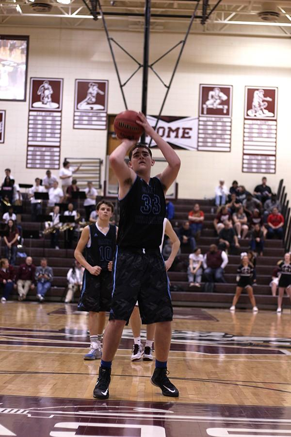 Freshman Braden Wiggs shoots a free throw against St. Charles West as his fellow freshman teammate Cameron Teson watches. Both their older brothers Brice and Casey started when they were freshman as well.