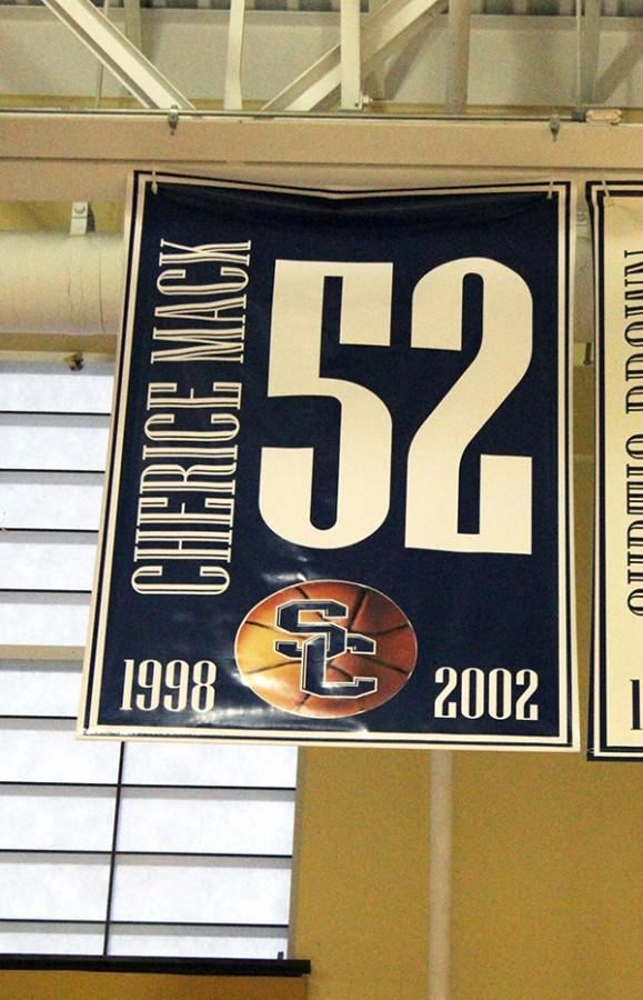 Cherice Mack-Jones' number 52 hangs in the rafters in the gym at St. Charles High.She is the first female in school history to have her number retired.