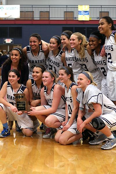 Team poses with district trophy.