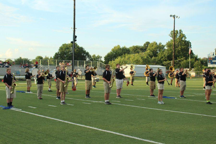 Band marching and performing before the Homecoming Game on Sept.  9.