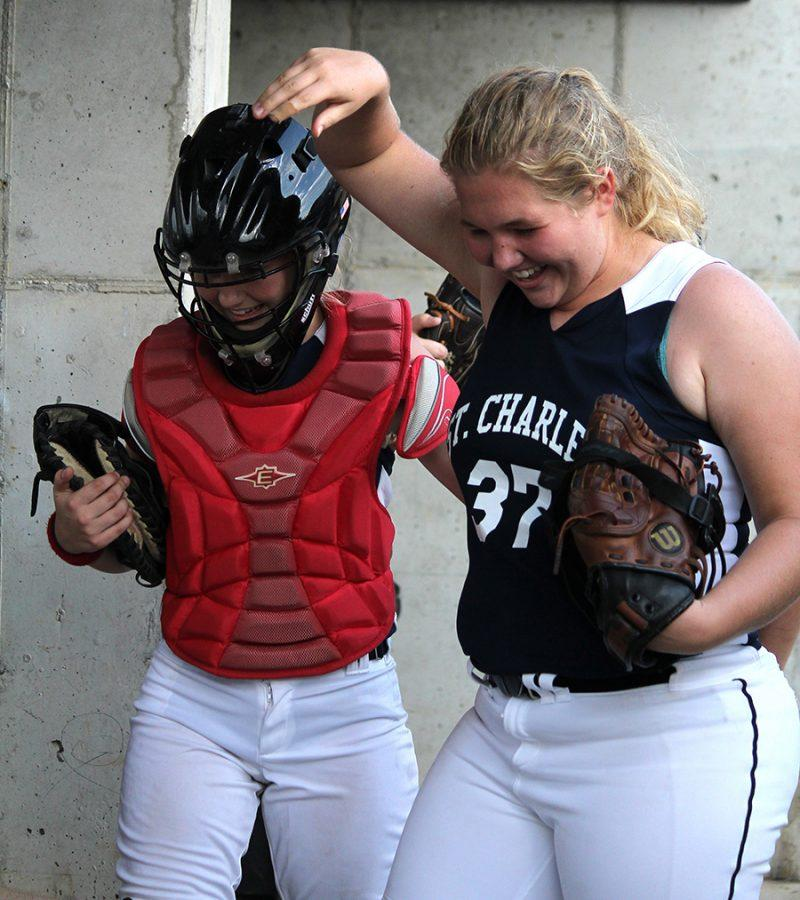 Sophomore pitcher Rachel Payne greets fellow freshman catcher Ryley Schaub during the home game against Fort Zumwalt East on Aug. 24