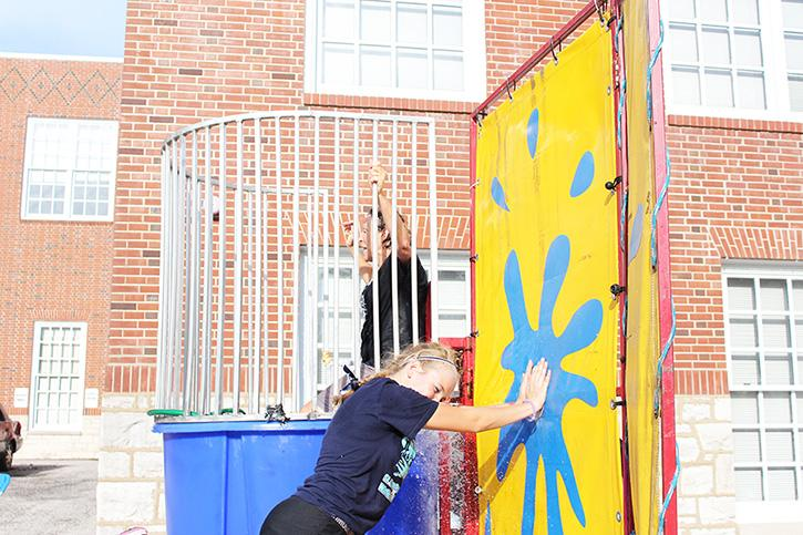 Freshman Ryley Schaub dunks English teacher Donette Goodlett at Homecoming Carnival.