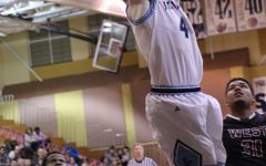 Senior Codi Whitlock rises up fr one of his two dunks during his teams 64-47 win over St. Charles West.