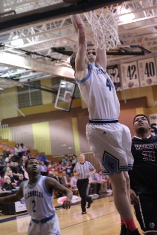 Senior Codi Whitlock rises up fr one of his two dunks during his team