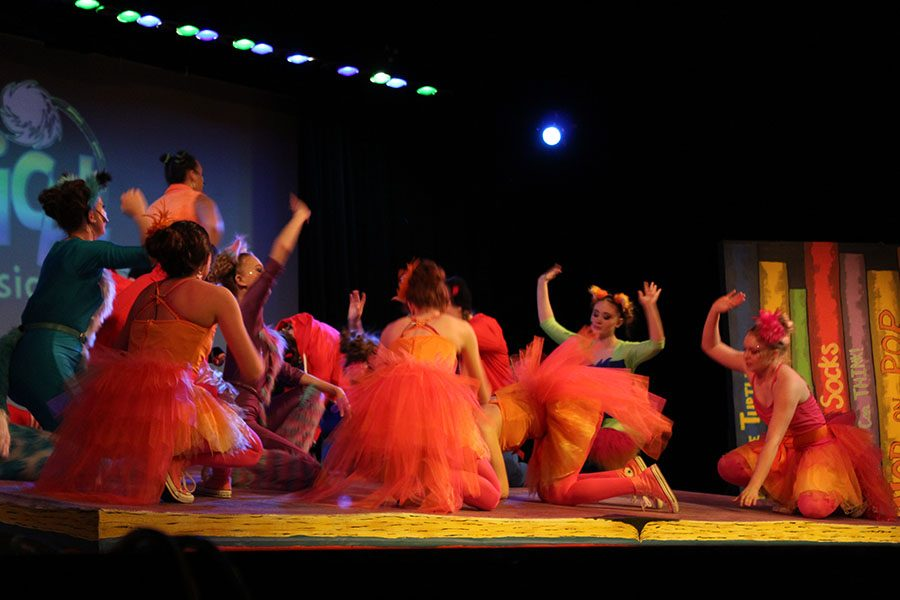 The cast of Seussical dances on stage.