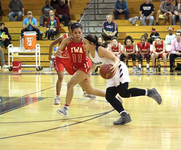 Senior guard Alexa Chairs drives the lane in the district championship versus Incarnate Word Academy in her final game for her team.