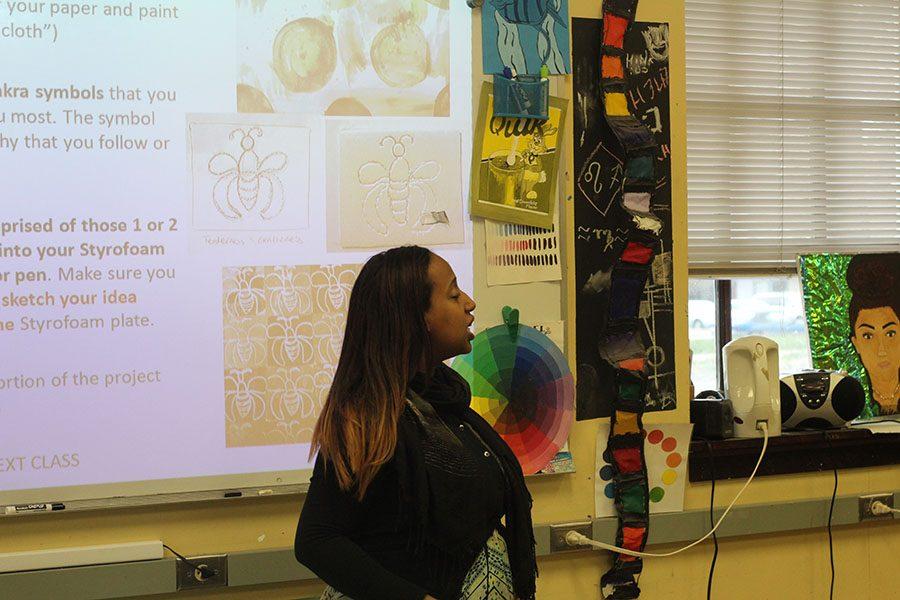 Art teacher Abigail Birhanu teaches about visual elements.