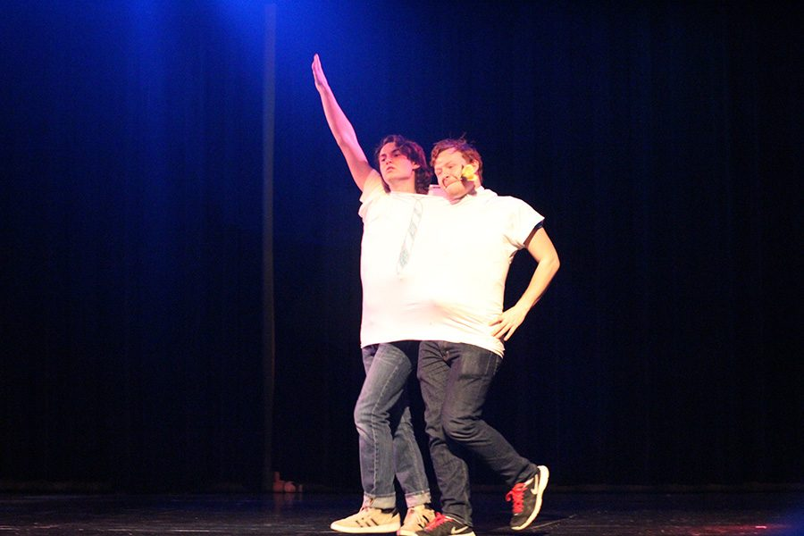 """Seniors Eric Myers and Damian Hawes strut onto the stage as """"conjoined twins"""". The two represented the newspaper and  the yearbook separately, but came together to create Mr. SCHS Publications."""