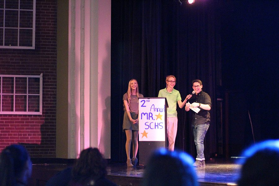 Junior Zac Snyder taught the audience to make a paper airplane.