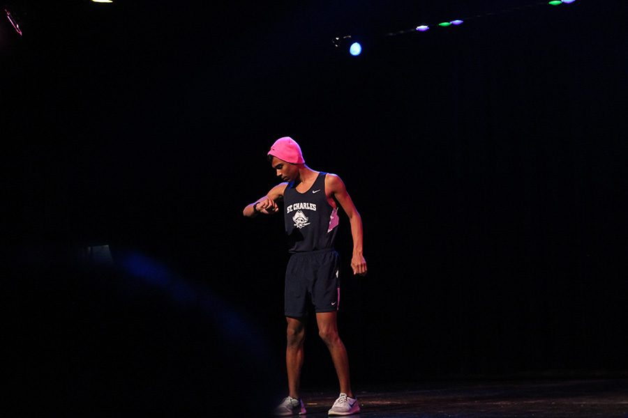 Senior Stephon Abron raced out in a pink hat and his cross country uniform. Abron was Mr. Cross Country.