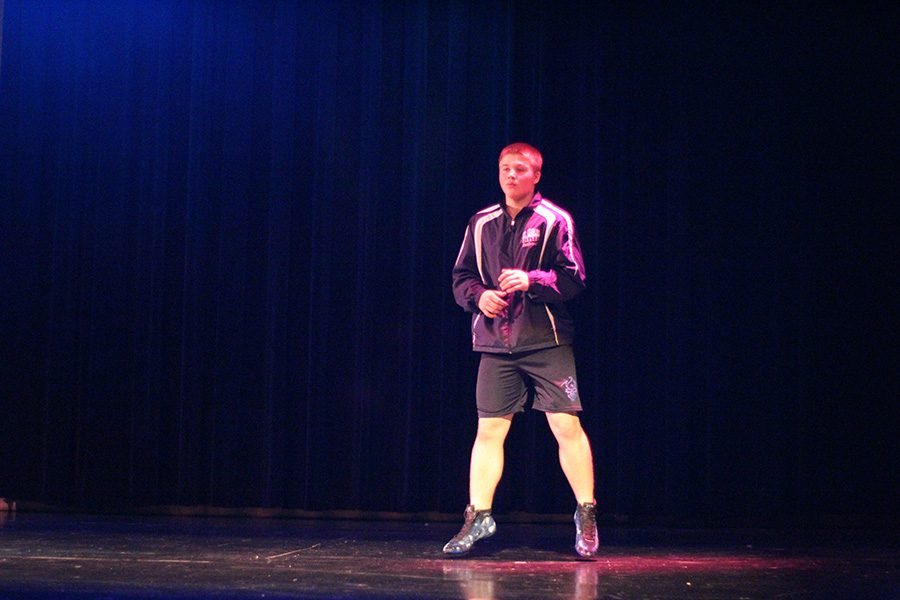 Freshman Justin Scarborough jumped onto stage in wrestling gear. Scarborough showed off his sporty side by being Mr. Wrestling.