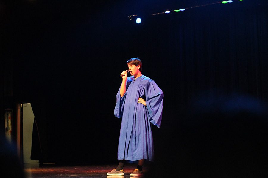 Sophomore Andrew Schappe walked on stage in a choir robe and pulled out a small microphone. He performed Proud Mary.