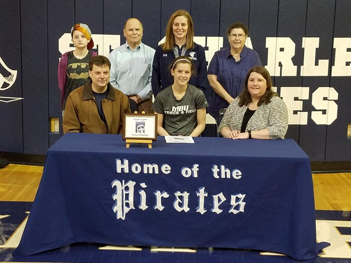 Senior Taylor Lyles signs her national letter of intent to run Cross Country and Track at Missouri Baptist University.