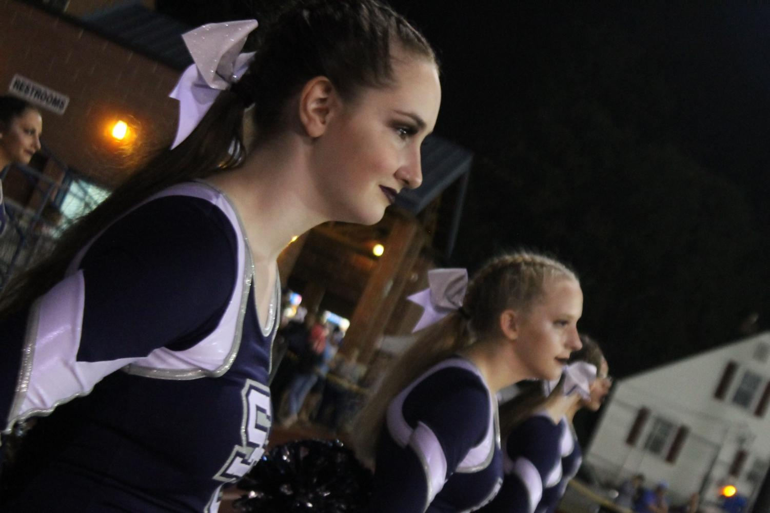 Marissa Sipe and Kat Lewis lined up with their team at a football game
