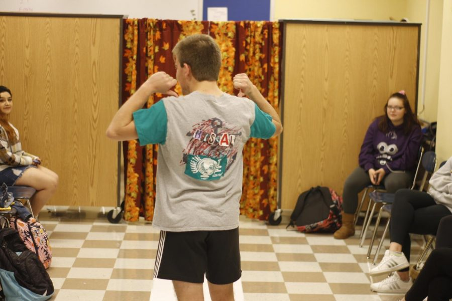 Ethan Ingram shows off the back of the outfit him and his group made.