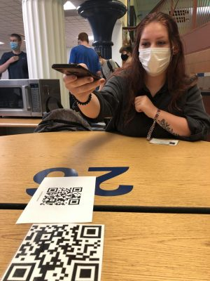 TABLE 26. During the school day of September 10th, Senior Madalynn Turner scans the QR code to sign into lunch. Due to COVID, students sign into lunch to mark where they sit for the day.