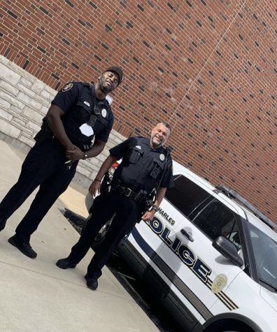 Officer Michael Shipley Stands next to new resource officer Jason Love.