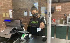 Aniyah Hamel running the register at her job.