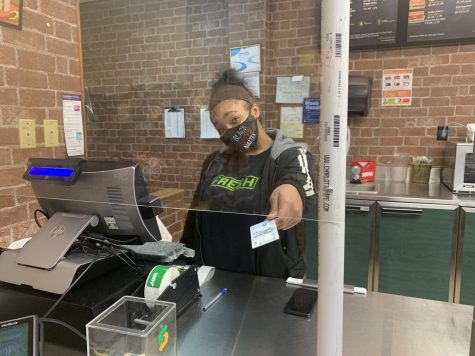 Aniyah Hamel running the register at her job.