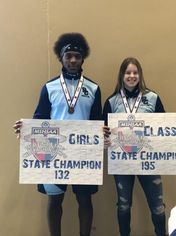 Seniors and Wrestling State Champions Trey Ward and Sabrina King celebrate their victories together