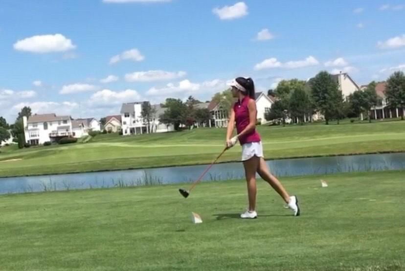 Senior Golfer Olivea Garson drives from the tee at an SCHS golf match