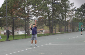 Nick Quay serves the ball.