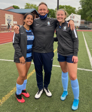 Bre Hollowell and Domenica Suraty with Coach Orrick