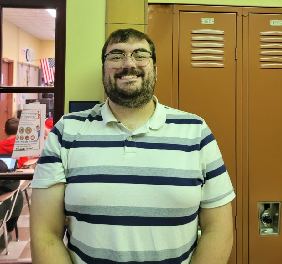 Mr. OKeefe smiling in front of B200, his Chemistry classroom.