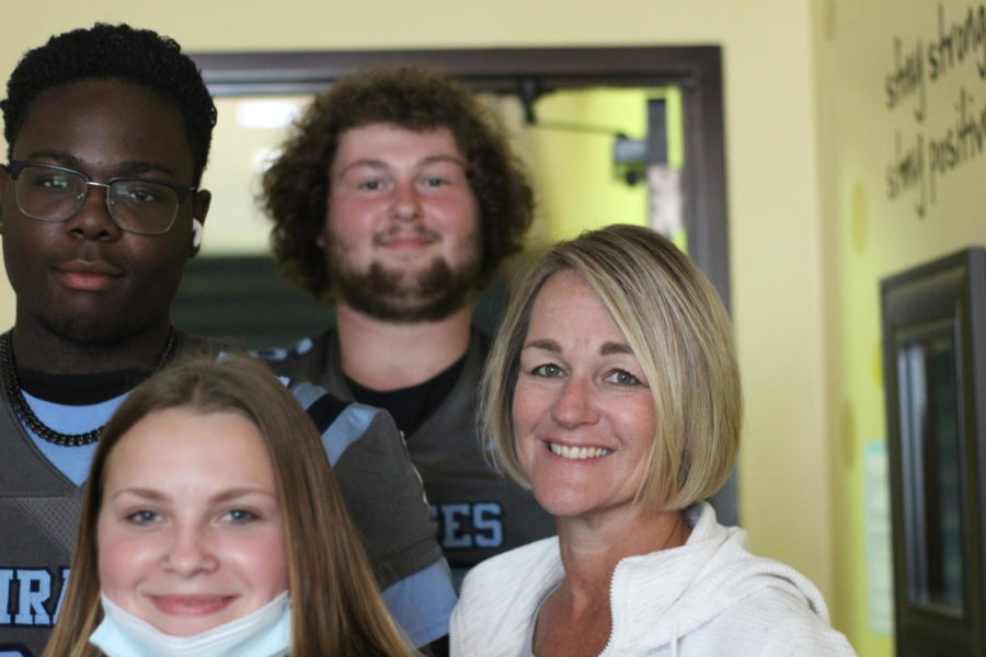 Mrs. Besselman poses with three of her students